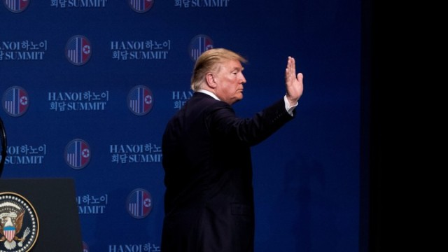 U.S. President Donald Trump waves as he leaves a news conference at the JW Marriott Hanoi, following talks with North Korean leader Kim Jong Un in Hanoi